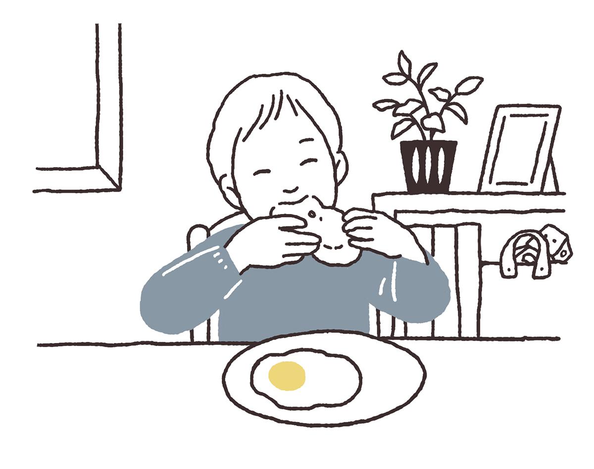 朝食をほおばる子供のイラスト